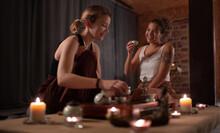 Woman Speaking With Tutor Brewing Tea