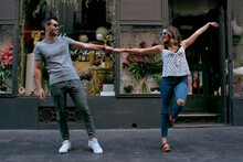 Couple In Love Dance Through The Streets Of The City