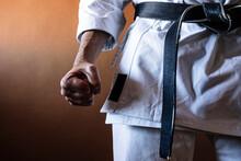 Unrecognizable Karateka With Black Belt In Firm Position