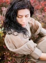 Analog Film Fashion Portrait Of Woman Sitting In Field In Dress