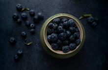 Bowl Of Fresh Ripe Blueberries On Dark Background. Top View