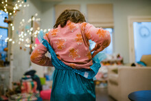 Little Girl Playing Dress Up With Christmas Gift Princess Outfit