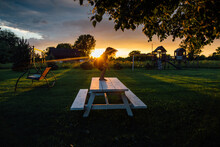 Little Boy Playing During Sunset On Picnic Table