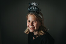 Portrait Of Young Girl With Happy New Year Hat Smiling