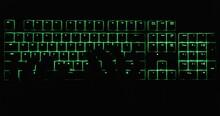 Hands Typing In The Dark On Illuminated Keyboard