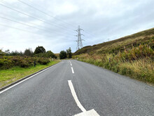 View Of, Huddersfield Road, With Wild Plants, Gorse, Trees, And A Cloudy Sky In, Rochdale, Lancashire, UK