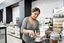 Female Coffee Shop Owner Preparing Espresso