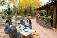 Retired Couple Friends Enjoying Lunch On Autumn Restaurant Patio