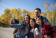 Happy Family Taking Selfie Before Hike In Sunny Autumn Parking Lot