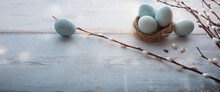 Tender Blue Easter Eggs With Pussy Willow On Gray Vintage Planks. Horizontal Background For Easter Concepts With Space For Text.