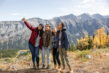 Mother And Daughter Hikers Taking Selfie On Scenic Autumn Mountain