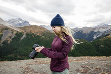 Young Woman With Digital SLR Camera In Majestic Canadian Rockies