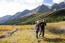 Couple Backpacking In Sunny Majestic Autumn Rocky Mountains, Canada
