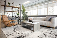Empty Highrise Office Sitting Area With Sofa And Armchair