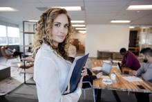 Portrait Confident Businesswoman In Coworking Space