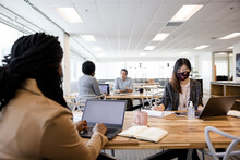 Business People In Face Masks Working In Coworking Space Office