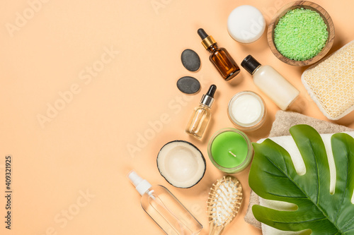 Spa and wellness products at trendy beige background. Flat lay image with copy space.