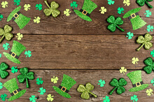 St Patricks Day Shamrock And Leprechaun Hat Frame. Overhead View Over A Rustic Wood Background With Copy Space.