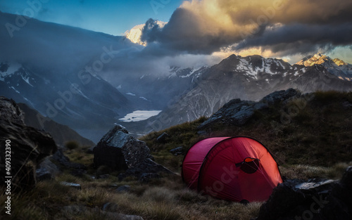 Obraz Camp tent looking over the mountains as clouds roll in - fototapety do salonu