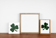 Mock Up Wood Frame With St Patricks Day Decor On A Wood Shelf. Rustic Wood Signs. Square Frame Against A White Wall. Copy Space.