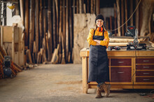 Positive Woman Working In Joinery Workshop