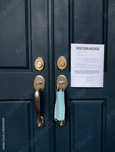 Obraz Home front door with eviction notice and facemask for renter in default during coronavirus pandemic - fototapety do salonu