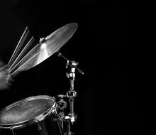 Stroboscopic Drummer Hitting Cymbals With Drum Sticks