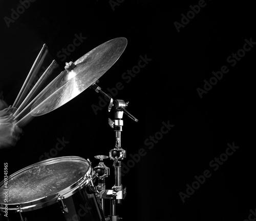 Fotografija Stroboscopic drummer hitting cymbals with drum sticks
