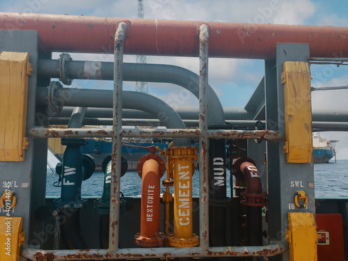 Fototapeta Offshore ship cargo manifolds ready to offload cargo to Floating production storage and offloading FPSO vessel, oil and gas indutry
