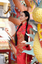 Portrait Of Asian Woman In The Chinese Dress And Chinese New Year Concept