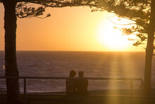 Nice Romantic Scene Sunset And A Couple Watching The Horizon In The Beach, Valentines Day, Perth, Australia.