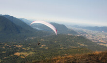 Paraglider Launching From Mount Elk In Canada