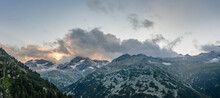 Aerial Drone Shot Of Clouds Over The Mountain At Schlegeisspeicher Reservoir During Sunset