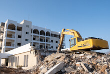 Crawler Excavator Working For The Demolition Of An Old Hotel. Excavator At Construction Side.