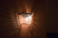 Bright Wall Lamp With Strands Of Faceted Glass