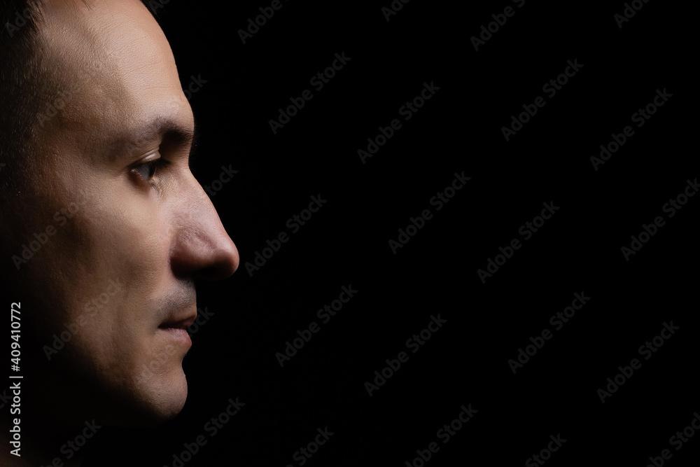 Fototapeta portrait of a man black background