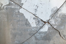 Concrete Cement Wall Was Cross Cracked In The House Where No People To Live. White Cement Construction Material Texture. Detail Of Ruin And Destruction. Texture Of Crack In The Old Wall