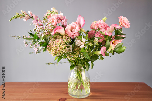 Bouquet 001. Finished flower arrangement in a vase for home. Flowers bunch, set for interior. Fresh cut flowers for decoration home. European floral shop. Delivery fresh cut flower. © malkovkosta