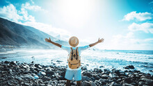 Happy Man With Arms Up Enjoying Freedom On The Beach - Hiker With Backpack Celebrating Success Outdoor - Blue Filter