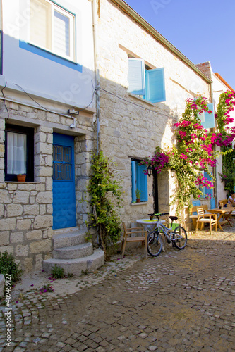 Fototapety, obrazy: colorful and stone houses in narrow street in Alacati cesme, izmir