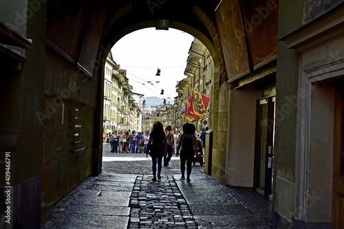 person walking in the street Fototapeta