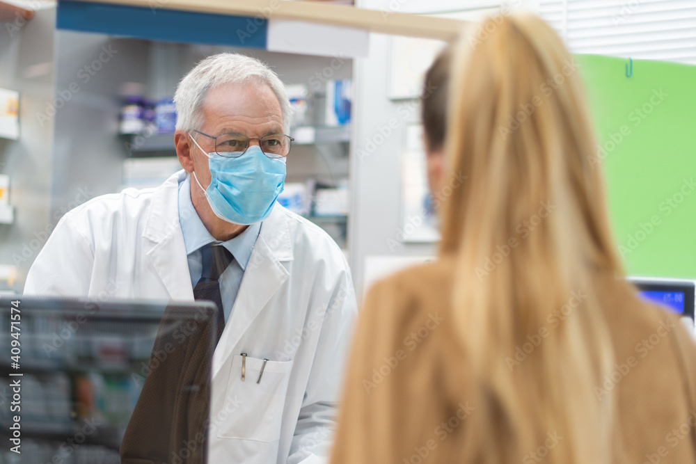 Fototapeta Woman checking out in a pharmacy