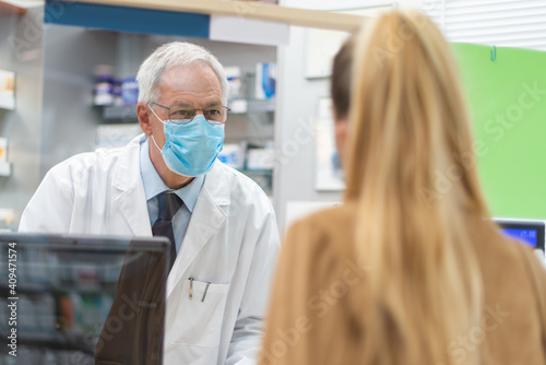 Obraz Woman checking out in a pharmacy - fototapety do salonu