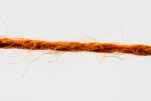 Red Fibrous Rope Against White Background