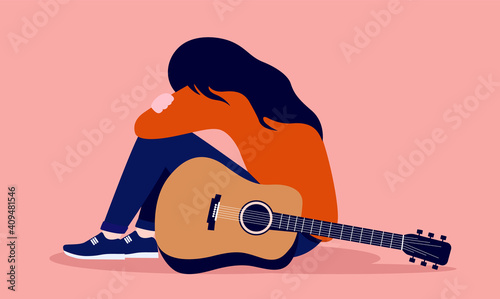 Fotografie, Obraz Sad girl with guitar sitting on floor - Musician writers block concept