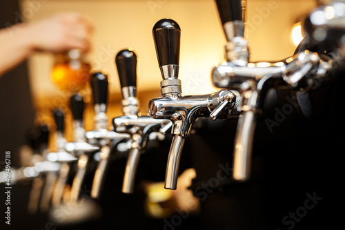 Obraz na plátně Row of taps in a beer tap.