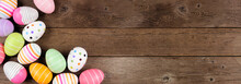 Colorful Easter Egg Corner Border. Top Down View Against A Rustic Wood Banner Background. Copy Space.