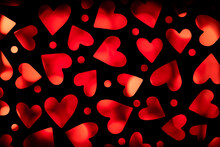 Lots Of Dark Silhouette Of Hearts Back Lit In Deep Red Color