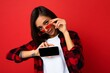 Leinwandbild Motiv Photo of sexy beautiful smiling young woman good looking wearing casual stylish outfit standing isolated on background with copy space holding smartphone showing phone in hand with empty screen
