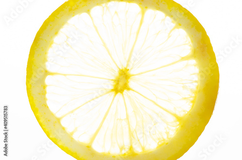 Fotografie, Obraz The lemon slice is transparent on a white background. Closeup
